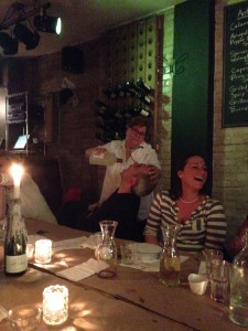 Rosa pouring Limoncello at the end of the night.
